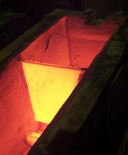 Wear coatings for continuous casting tundishes